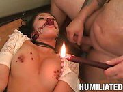 Hot wax on her tits