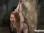 Redhead struggles in bondage