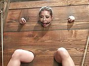 Submissive placed in stocks