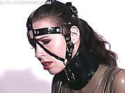 Latex catsuit and bridle