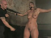 Chained blonde is hosed down