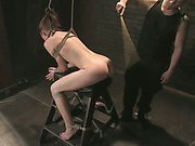 Bound girl is whipped