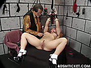 Pussy is spread with clamps