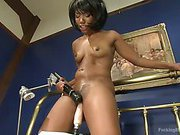 Smooth dark-skinned all natural babe machine fucked