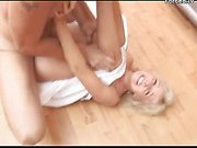 Blonde girl forced on the floor