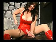 Lady holds smother slave ball and spanking