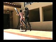 Fearer mistress wipping standing slave body