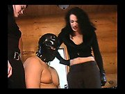 Masked man doing his  handling before two mistress
