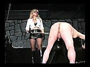 Cruel mistress beating by stick o slave ass