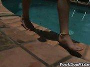 Redhead mistress using footdom slave