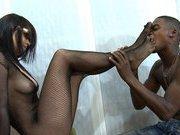 Fishnet mistress likes interracial footworship
