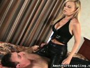 Latex mistress canning and humiliating a slave