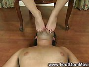 Femdom bitch footjob domina