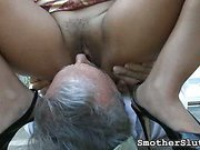 Elderly smothering slave acting outdoors