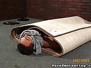 Suffocated slave packed into carpet