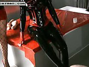 Latex mistresses fuck slave's asshole