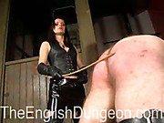 Cruel mistress caned slave's ass