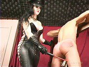 Mature latex mistress torturing slave's body