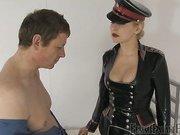 Obedient slave licking mistress's heels