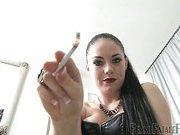 Smoking mistress waiting for slave