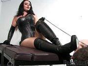 Corset mistress facesitting her slave