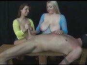 Mistresses jerking masked slave's dick
