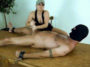 Mistress jerking bound slave's cock