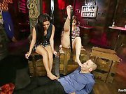 Two mistresses use foot slave