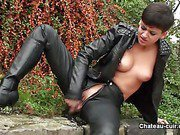 Biker girl in leather masturbates