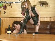 Guy getting spankng from his Mistresses