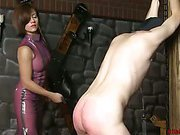 Latex Mistress Whipping a Slave