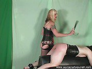 Mistress Kelly spanks and paddles her slave on the spanking