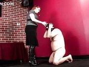 BDSM dominatrix having her slave on knees