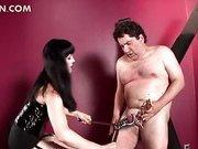 Slutty mistress using BDSM torture on her man