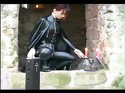 Hot domina plays with herself outdoors