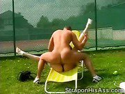 Tennis MILF fucks horny guys up the ass with her strap on