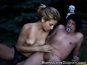 Slim mommy plays with her adultbabys cock in outdoors
