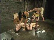 Four-way fem dom bondage scene