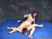 Hot brunette wrestling with her partner