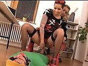 Dominant young babes use a slave for humiliating sex
