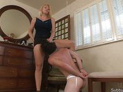 Blonde mistress in dress forced slave to pussy licking