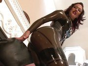 Babe in latex sat on slaves face