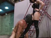 Sexy brunette tramples her foot slave