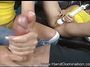 Twisted twins stroke slave's dick