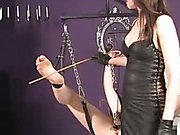 Restrained slave endures several punishments