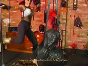 Mistress kicks her tied slave