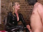 Rubber Madam uses her slave for pleasure