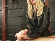Mistress in gloves makes humiliation handjob