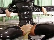 Rubber mistress plays with her slave