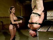 Hot dominatrix punishes her tied slave